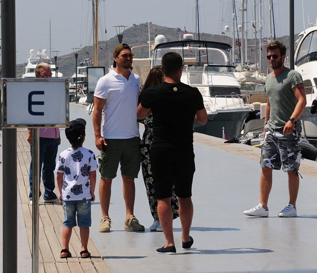 cagatay ulusoy and kivanc tatlitug are talking in bodrum yacht marina