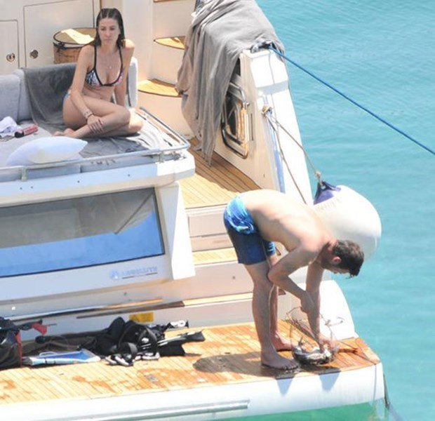 kivanc tatlitug is fishing in yacht
