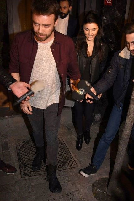 Hande Ercel and Murat Dalkilic together hand-to-hand